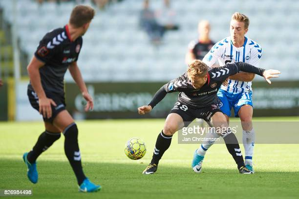 Yann Rolim of AaB Aalborg and Casper Nielsen of OB Odense compete for the ball during the Danish Alka Superliga match between OB Odense and AaB...