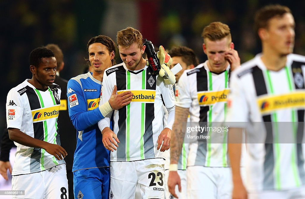 <a gi-track='captionPersonalityLinkClicked' href=/galleries/search?phrase=Yann+Sommer&family=editorial&specificpeople=5781332 ng-click='$event.stopPropagation()'>Yann Sommer</a> (L), goalkeeper of Gladbach comforts teammate <a gi-track='captionPersonalityLinkClicked' href=/galleries/search?phrase=Christoph+Kramer&family=editorial&specificpeople=5588926 ng-click='$event.stopPropagation()'>Christoph Kramer</a> after the Bundesliga match between Borussia Dortmund and Borussia moenchengladbach at Signal Iduna Park on November 9, 2014 in Dortmund, Germany.