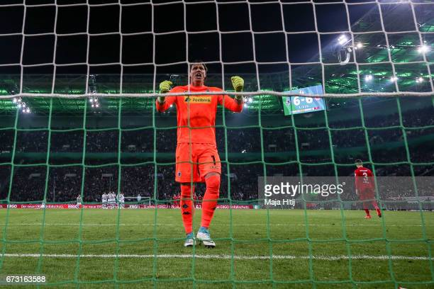 Yann Sommer goalkeeper of Moenchengladbach celebrates after Guillermo Varela of Frankfurt misses a goa during penalty shoot out against Lukas...
