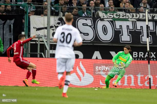 Yann Sommer of Borussia Moenchengladbach controls the ball after a shot on target of Robert Lewandowski of FC Bayern Muenchen during the Bundesliga...