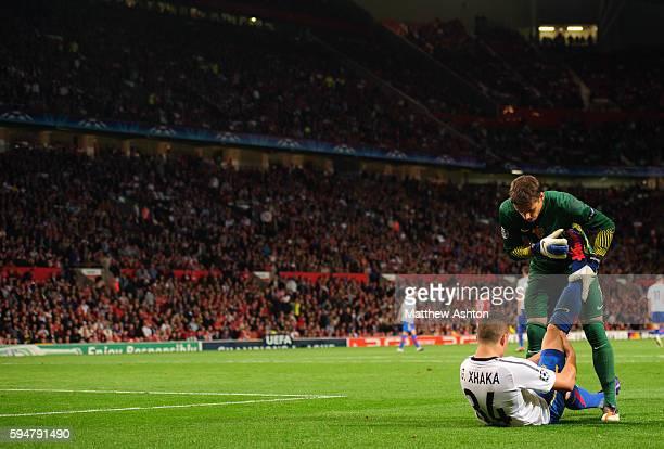 Yann Sommer of FC Basel treats Granit Xhaka of FC Basel for cramp
