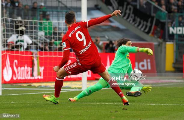Yann Sommer of Moenchengladbach in action against Robert Lewandowski of Bayern Munich during the Bundesliga Match between Borussia Moenchengladbach...
