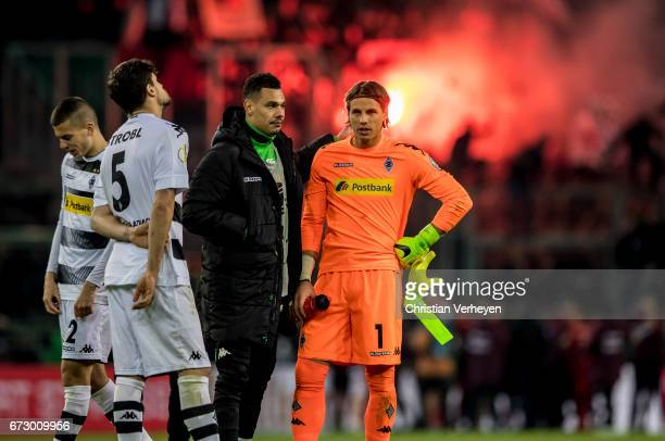 Yann Sommer Timothee Kolodziejczak and Tobias Strobl of Borussia Moenchengladbach look disappointed after the DFB Cup Semi Final between Borussia...