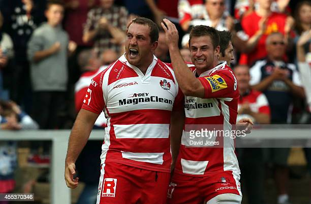 Yann Thomas and Henry Trinder of Gloucester Rugby celebrate a try against Sale Sharks during the Aviva Premiership match between Gloucester Rugby and...