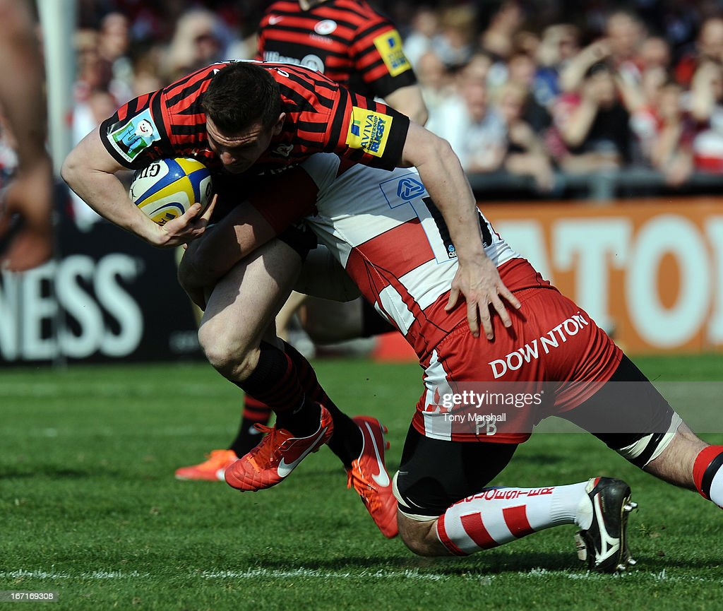 Yann Thomas of Gloucester tackles Ben Spencer of Saracens during the Aviva Premiership match between Gloucester and Saracens at Kingsholm Stadium on April 20, 2013 in Gloucester, England.