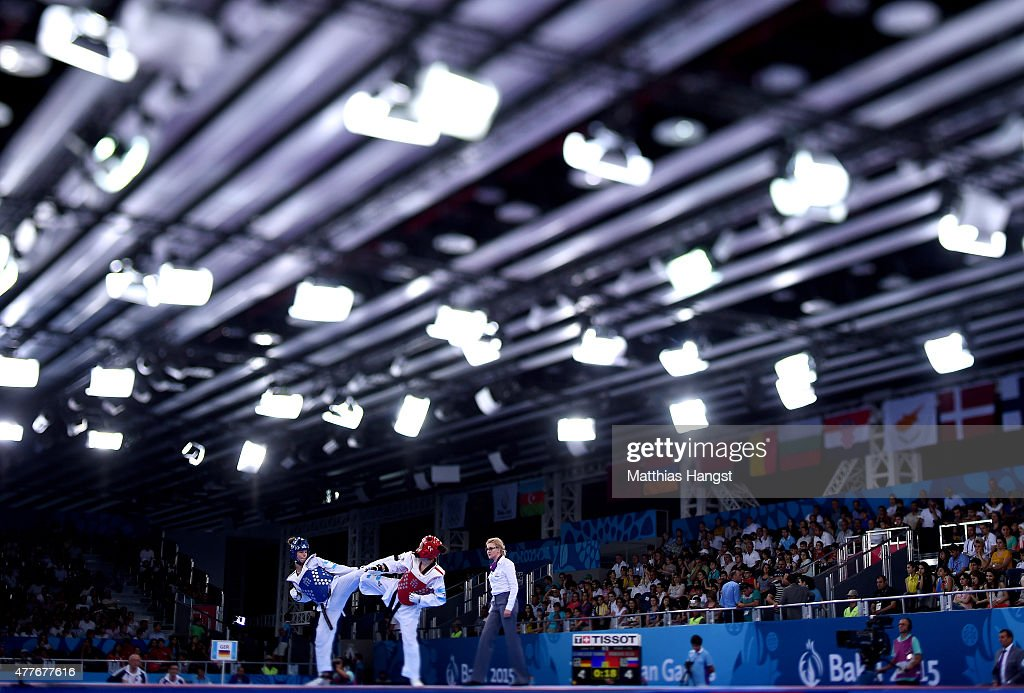 Yanna Scheider of Germany and Olga Ivanova of Russia compete in the Women's 67kg Taekwondo Preliminary Round during day seven of the Baku 2015...