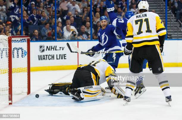 Yanni Gourde and Dan Girardi of the Tampa Bay Lightning celebrate a goal against goalie Antti Niemi and Evgeni Malkin of the Pittsburgh Penguins...