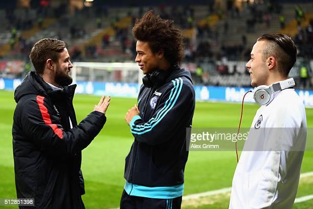Yanni Regaesel of Frankfurt Leroy Sane of Schalke and Marc Stendera of Frankfurt chat prior to the Bundesliga match between Eintracht Frankfurt and...