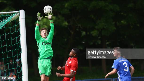 Yannic lenze of Schalke saves the ball against Franck Evina of Bayern during the B Juniors German Championship Semi Final match between FC Schalke...