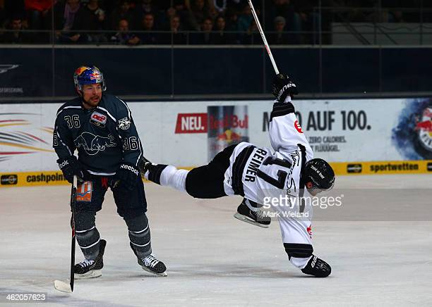 Yannic Seidenberg of EHC Red Bull Muenchen checks Patrick Reimer of Thomas Sabo Ice Tigers during the DEL match between EHC Red Bull Muenchen and...