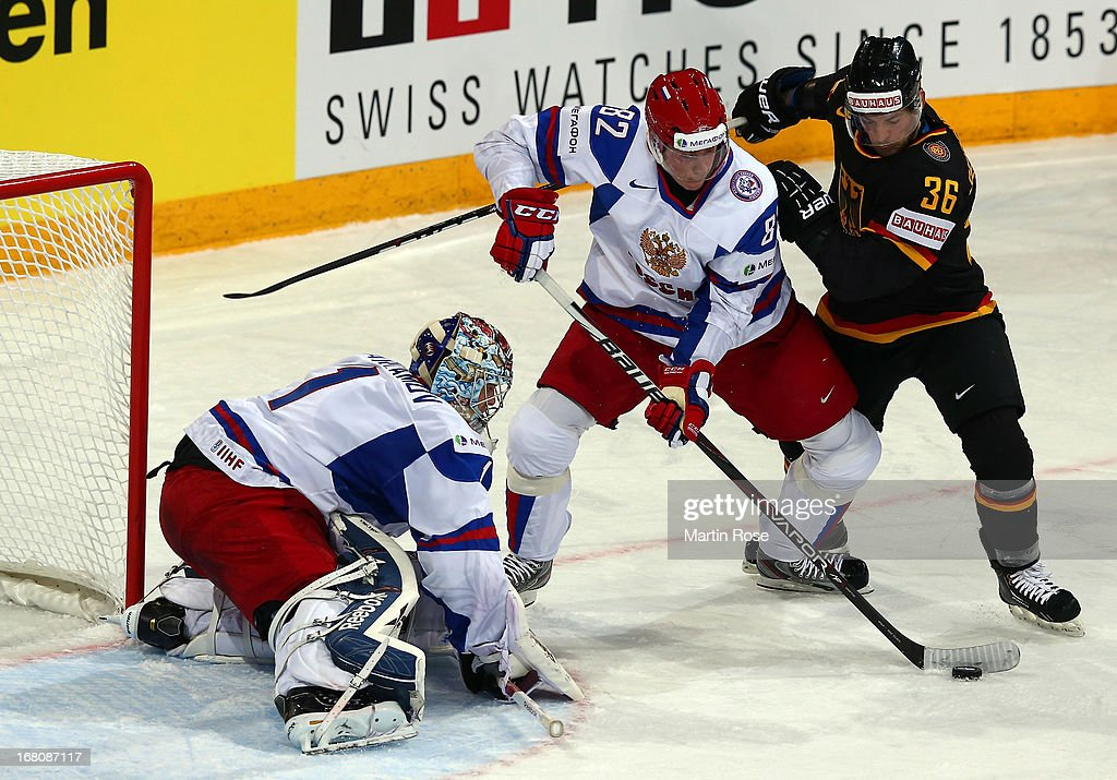Yannic Seidenberg (#36) of Germany and Yevgeni Medvedev (#82) of Russia battle for the puck during the IIHF World Championship group H match between Germany and Russia at Hartwall Areena on May 5, 2013 in Helsinki, Finland.