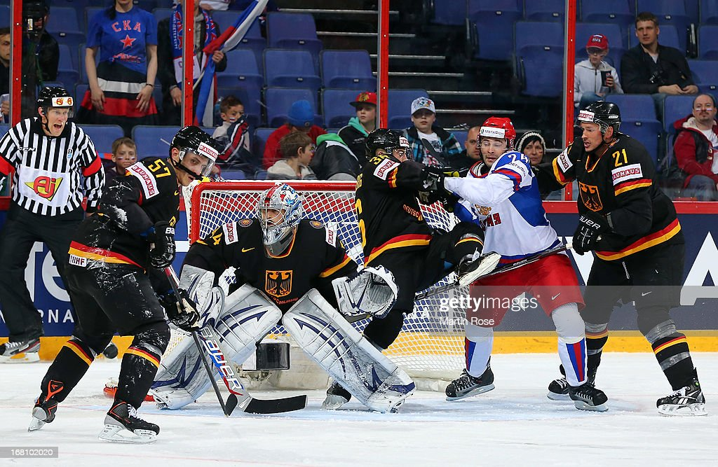 Yannic Seidenberg (#36) of Germany battles for position with Alexander Popov (#24) of Russia during the IIHF World Championship group H match between Germany and Russia at Hartwall Areena on May 5, 2013 in Helsinki, Finland.