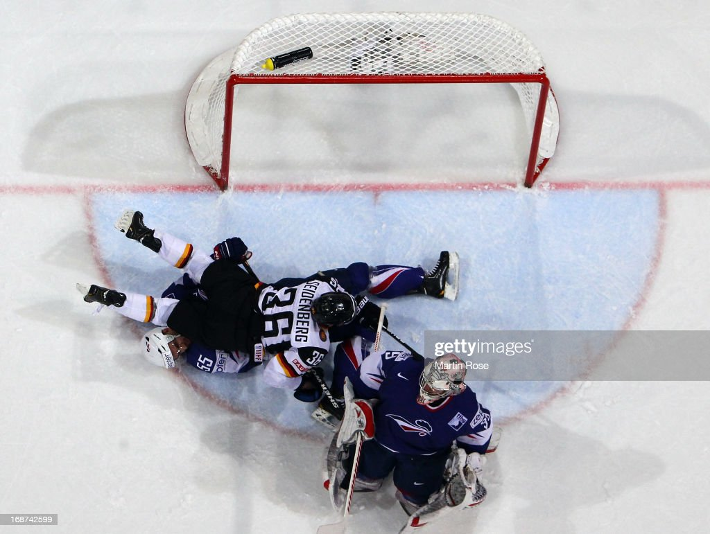 Yannic Seidenberg (#36) of Germany lies on Jonathan Janil (#55) of France during the IIHF World Championship group H match between France and Germany at Hartwall Areena on May 14, 2013 in Helsinki, Finland.