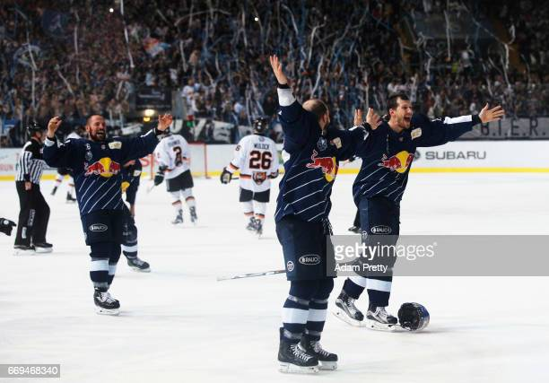 Yannic Seidenberg of Muenchen and his team mates celebrate winning the DEL PlayOffs Final Match 5 between EHC Muenchen and the Grizzlys Wolfsburg at...