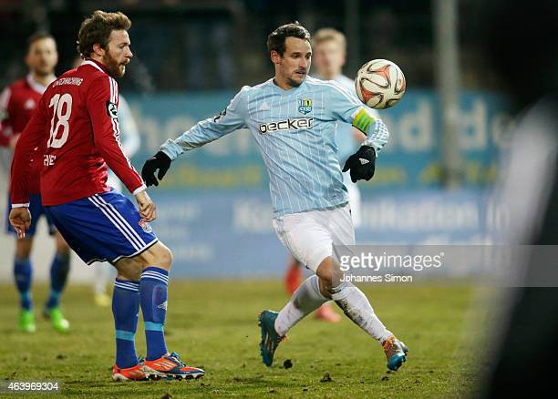 Yannic Thiel of Unterhaching and Anton Fink of Chemnitz fight for the ball during the Third League match between SpVgg Unterhaching and Chemnitzer FC...