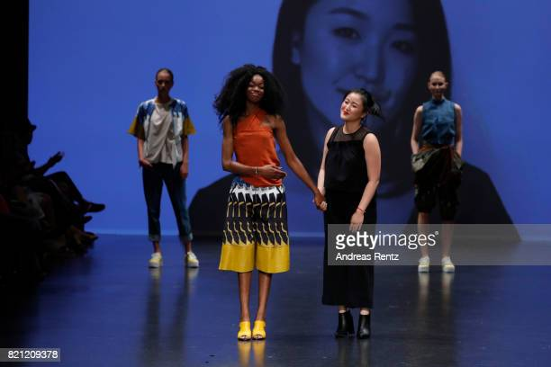 Yannica Shu acknowledges the audience after her show 'RECONCEPTION' at the AMD Exit17_2 show during Platform Fashion July 2017 at Areal Boehler on...