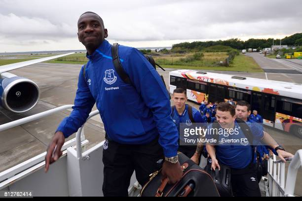 Yannick Bolasie boards a plane at Liverpool John Lennon Airport as the team prepare to travel to Tanzania for a preseason friendly on July 11 2017 in...