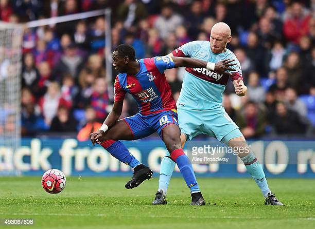 Yannick Bolasie of Crystal Palace and James Collins of West Ham United compete for the ball during the Barclays Premier League match between Crystal...