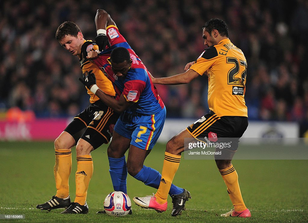 Yannick Bolasie of Crystal Palace battles with <a gi-track='captionPersonalityLinkClicked' href=/galleries/search?phrase=Alex+Bruce+-+Soccer+Player+-+Born+1984&family=editorial&specificpeople=12317845 ng-click='$event.stopPropagation()'>Alex Bruce</a> of Hull City during the npower Championship match between Crystal Palace and Hull City at Selhurst Park on March 5, 2013 in London, England.