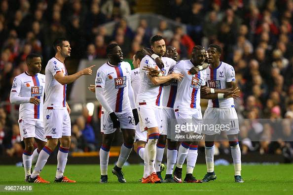 Yannick Bolasie of Crystal Palace celebrates with his team mates after scoring the opening goal during the Barclays Premier League match between...