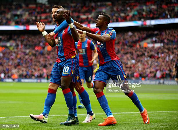 Yannick Bolasie of Crystal Palace celebrates with team mates as he score their first goal during The Emirates FA Cup semi final match between Watford...