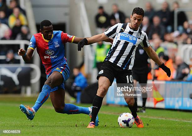 Yannick Bolasie of Crystal Palace challenges Hatem Ben Arfa of Newcastle United during the Barclays Premier League match between Newcastle United and...