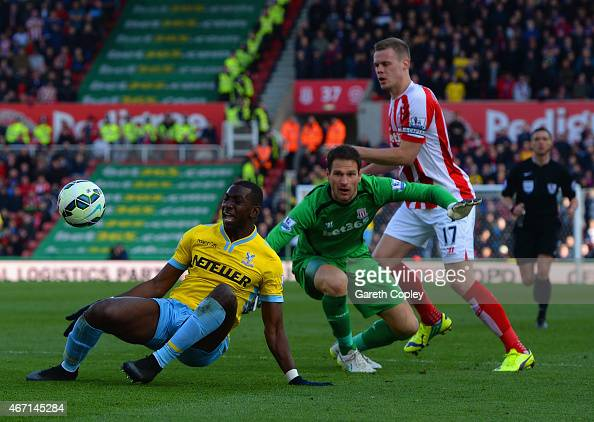 Yannick Bolasie of Crystal Palace draws a foul from Asmir Begovic of Stoke City to win a penalty during the Barclays Premier League match between...