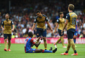 Yannick Bolasie of Crystal Palace gestures after being fouled by Francis Coquelin of Arsenal during the Barclays Premier League match between Crystal...