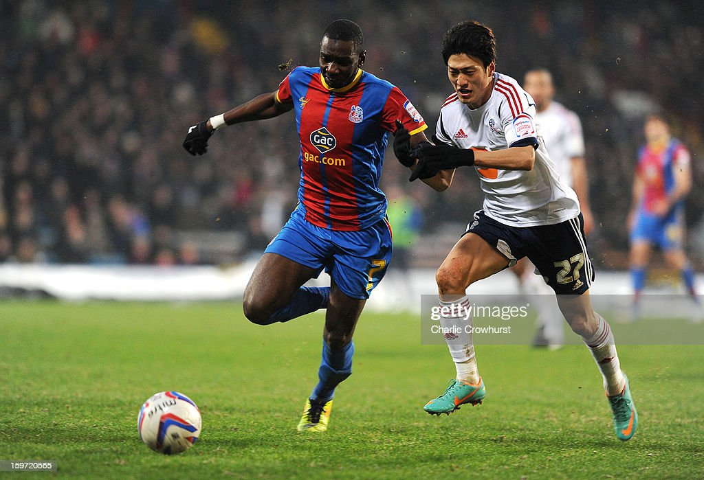 Yannick Bolasie (L) of Crystal Palace holds off Chung-Yong Lee of Bolton during the npower Championship match between Crystal Palace and Bolton at Selhurst Park on January 19, 2013 in London England.