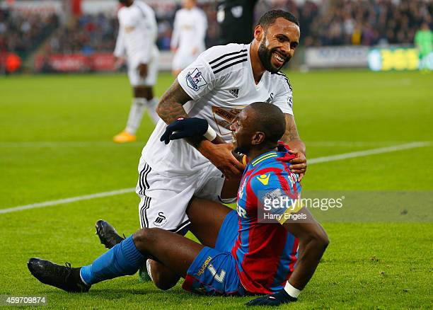 Yannick Bolasie of Crystal Palace jokes with Kyle Bartley of Swansea City during the Barclays Premier League match between Swansea City and Crystal...