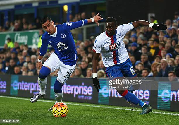 Yannick Bolasie of Crystal Palace takes on Ramiro Funes Mori of Everton during the Barclays Premier League match between Everton and Crystal Palace...