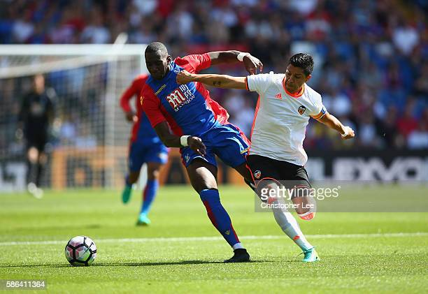 Yannick Bolasie of Palace battles with Enzo Perez of Valencia during the Pre Season Friendly match between Crystal Palace and Valencia at Selhurst...
