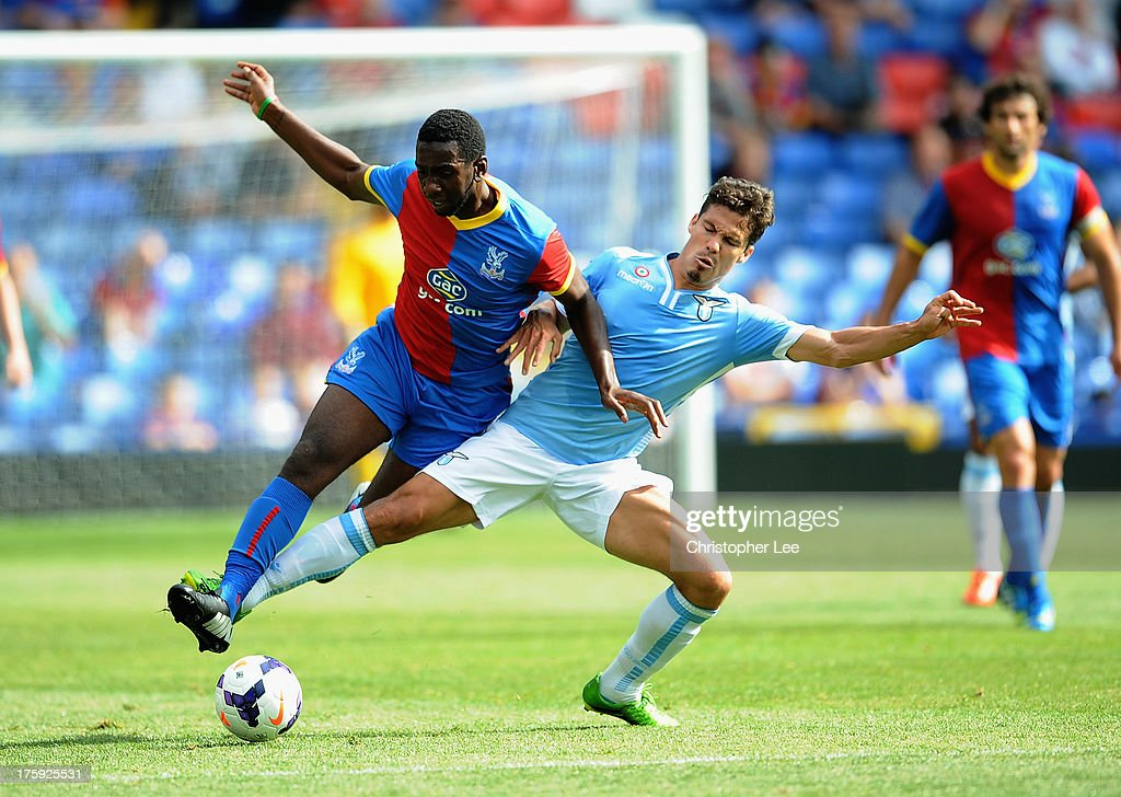 <a gi-track='captionPersonalityLinkClicked' href=/galleries/search?phrase=Yannick+Bolasie&family=editorial&specificpeople=6135147 ng-click='$event.stopPropagation()'>Yannick Bolasie</a> of Palace battles with <a gi-track='captionPersonalityLinkClicked' href=/galleries/search?phrase=Hernanes&family=editorial&specificpeople=4522139 ng-click='$event.stopPropagation()'>Hernanes</a> of Lazio during a Pre Season Friendly between Crystal Palace and Lazio at Selhurst Park on August 10, 2013 in London, England.
