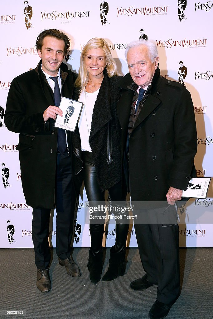 Yannick Bollore with his wife Chloe Bollore and Philippe Labro attend the 'Yves Saint Laurent' Paris movie Premiere at Cinema UGC Normandie on December 19, 2013 in Paris, France.