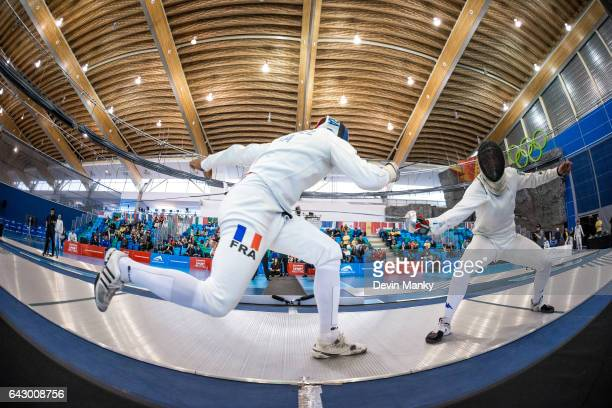 Yannick Borel of France fences Paolo Pizzo of Italy during the bronze medal match in team competition at the Peter Bakonyi Senior Men's Epee World...