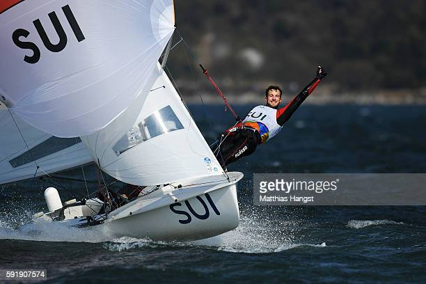Yannick Brauchli of Switzerland and Romuald Hausser of Switzerland compete in the Men's 470 class medal race at the Marina da Gloria on Day 13 of the...
