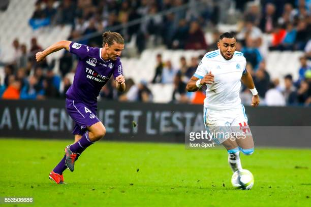Yannick Cahuzac of Toulouse and Dimitri Payet of Marseille during the Ligue 1 match between Olympique Marseille and Toulouse at Stade Velodrome on...