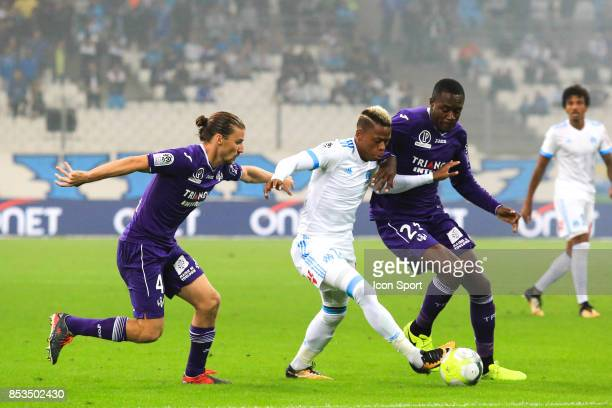 Yannick Cahuzac of Toulouse Clinton Njie of Marseille and Giannelli Imbula of Toulouse during the Ligue 1 match between Olympique Marseille and...