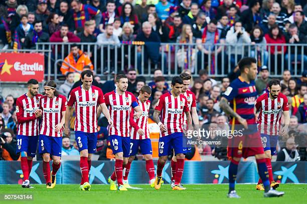 Yannick Carrasco Filipe Luis Diego Godin Gabi Fernandez Antoine Griezmann Augusto Fernandez Saul Niguez and Juanfran Torres of Club Atletico de...