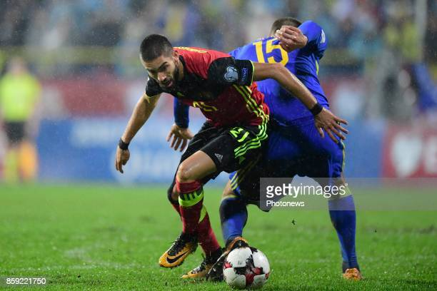 Yannick Carrasco forward of Belgium beats Toni Sunjic defender of Bosnia Herzegovina to the ball during the World Cup Qualifier Group H match between...