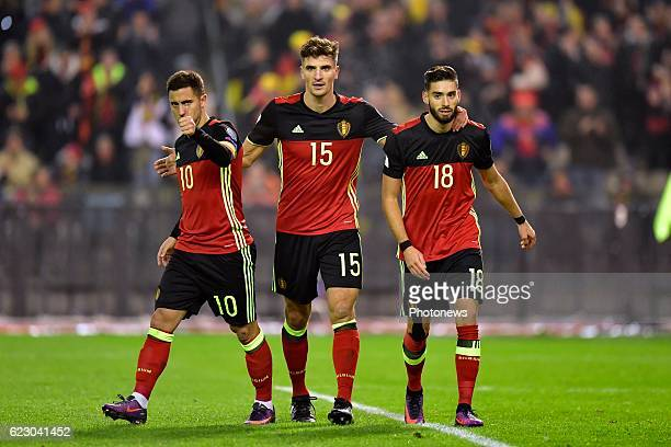 Yannick Carrasco forward of Belgium celebrates scoring a goal with teammates Thomas Meunier defender of Belgium an Eden Hazard midfielder of Belgium...