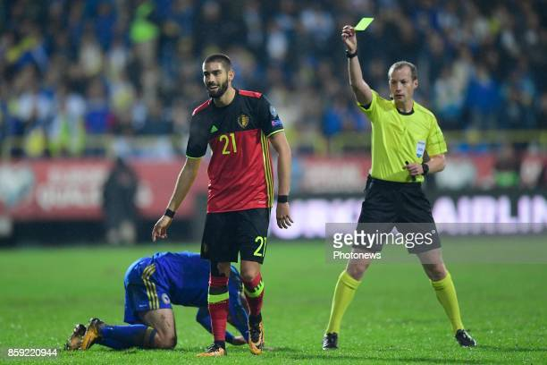 Yannick Carrasco forward of Belgium is shown a yellow card during the World Cup Qualifier Group H match between Bosnia and Herzegovina and Belgium at...