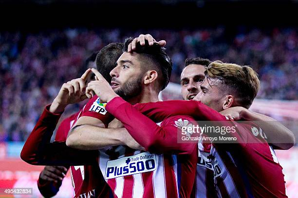 Yannick Carrasco of Atletico de Madrid celebrates scoring their second goal with teammates Antoine Griezmann and Koke during the La Liga amtch...