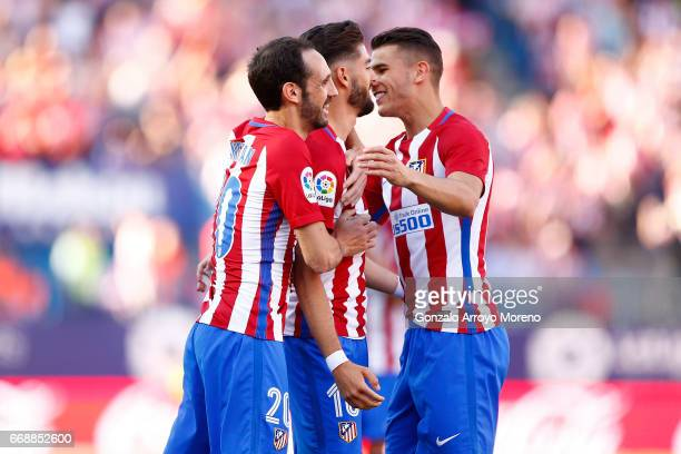 Yannick Carrasco of Atletico de Madrid celebrates scoring their opening goal with teammates Juan Francisco Torres alias Juanfran and Lucas Hernandez...