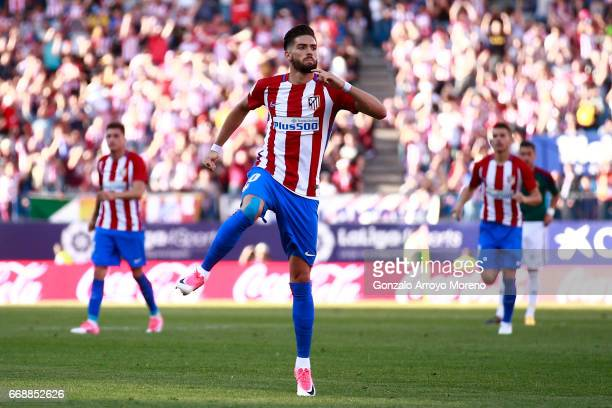 Yannick Carrasco of Atletico de Madrid celebrates scoring their opening goal during the La Liga match between Club Atletico de Madrid and CA Osasuna...