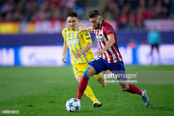 Yannick Carrasco of Atletico de Madrid competes for the ball with Serikzhan Muzhikov of FC Astana during the UEFA Champions League Group C match...