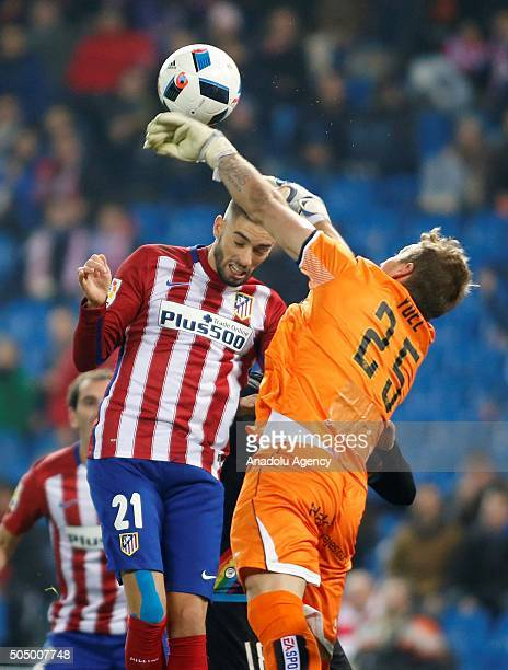 Yannick Carrasco of Atletico de Madrid vies with Yoel Rodriguez of Rayo Vallecano de Madrid during the Copa del Rey Round of 16 second leg match...