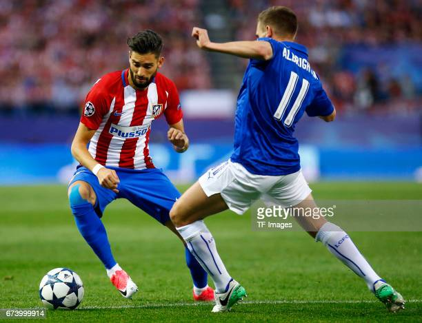 Yannick Carrasco of Atletico Madrid and Marc Albrighton of Leicester City battle for the ball during the UEFA Champions League Quarter Final first...