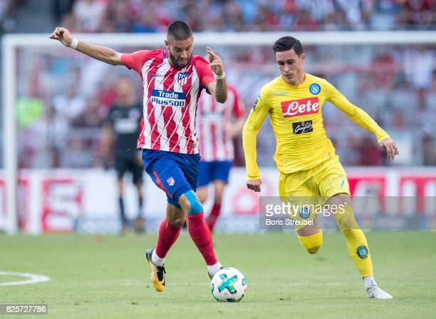Yannick Carrasco of Atletico Madrid battles for the ball with Jose Callejon of SSC Napoli during the Audi Cup 2017 match between Club Atletico de...