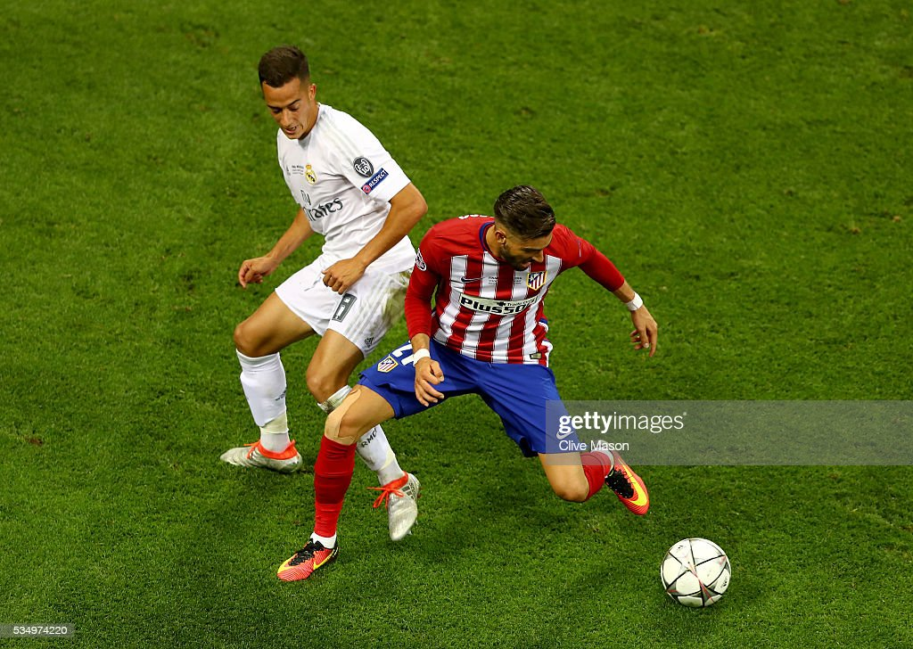 Yannick Carrasco of Atletico Madrid battles for the ball with Lucas Vazquez of Real Madrid during the UEFA Champions League Final match between Real Madrid and Club Atletico de Madrid at Stadio Giuseppe Meazza on May 28, 2016 in Milan, Italy.